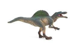 Jouet gris de spinosaurus de vue de côté sur le fond blanc photographie stock libre de droits