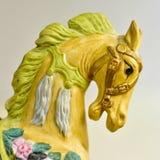 Jouet jaune de carrousel de cheval Image libre de droits