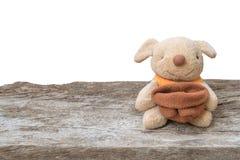 Jouet mignon de chiot sur le bois Photographie stock libre de droits