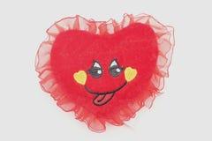 Jouet mou au coeur d'amour avec le visage mignon Photographie stock libre de droits