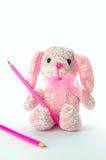 Jouet mou de fille avec un crayon Image stock