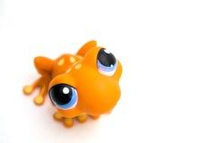 Jouet orange de grenouille photographie stock
