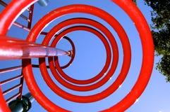 Jouet rouge de cour de jeu photographie stock libre de droits