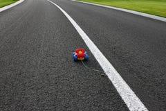 Jouet sur la route Images libres de droits