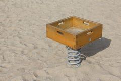 Jouet sur le terrain de jeu extérieur dans le bac à sable Image stock
