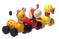 Jouets animaux de roulement en bois d'isolement Images stock