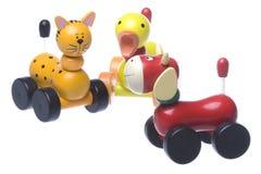 Jouets animaux de roulement en bois d'isolement Photo libre de droits