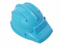 Jouets : Casque en plastique bleu lumineux de construction Image libre de droits