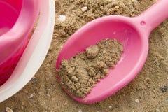 Jouets dans le sable Photographie stock libre de droits