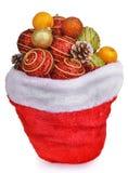 Jouets de Noël d'esprit de sac du père noël et cônes de pin Photo stock