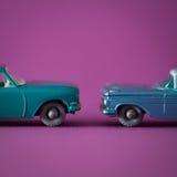 2 jouets en métal dans le studio Photographie stock libre de droits