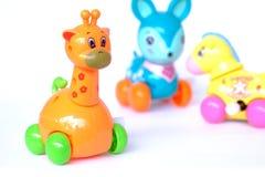 Jouets en plastique de bébé de girafe de cerfs communs de cheval photographie stock