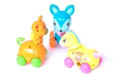 Jouets en plastique de bébé de girafe de cerfs communs de cheval photos libres de droits