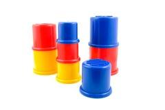 Jouets en plastique empilés Photo stock