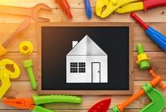 Jouets et tableau d'outils de travail sur un plancher en bois Photographie stock
