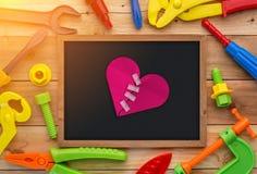 Jouets et tableau d'outils de travail sur un plancher en bois jpg Photographie stock