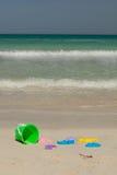 Jouets sur la plage Photographie stock libre de droits