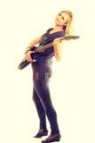Joueur d'artiste de femme avec la guitare électrique Image stock