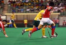 Joueur d'hockey dans l'action Photos stock