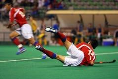 Joueur d'hockey dans l'action Images stock