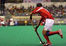 Joueur d'hockey dans l'action Photo libre de droits