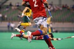 Joueur d'hockey dans l'action Photo stock