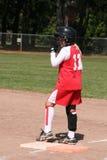 Joueur de base-ball sur la base Photos stock