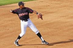Joueur de baseball prêt à projeter Photographie stock libre de droits