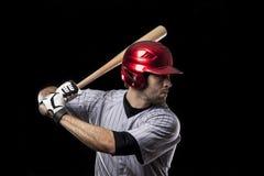 Joueur de baseball sur un uniforme rouge. photos stock