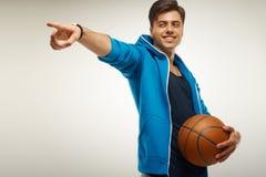 Joueur de basket avec la bille Portrait photos stock