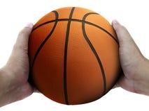 Joueur de basket tenant une boule sur le fond blanc photos stock