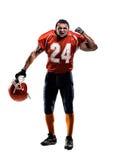 Joueur de football américain dans le blanc d'action d'isolement Image stock