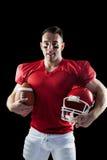Joueur de football américain regardant l'appareil-photo Images libres de droits