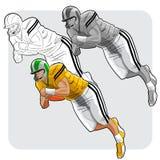 Joueur de football américain sautant Photographie stock