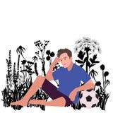Joueur de football avec la relaxation de boule sur le pré Photo libre de droits