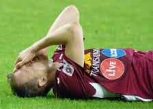 Joueur de football blessé Image stock
