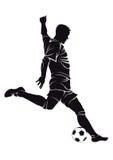 Joueur de football (le football) avec la boule Photographie stock