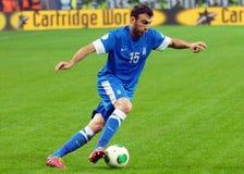 Joueur de football pendant la série éliminatoire de coupe du monde de la FIFA Photographie stock libre de droits