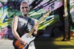 Joueur de guitare de musique extérieur Photographie stock