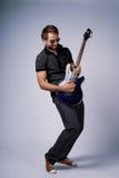 Joueur de guitare de Rockstar Images libres de droits