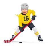 Joueur de hockey dans l'uniforme jaune Image libre de droits