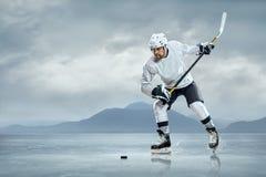 Joueur de hockey de glace photographie stock