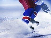 Joueur de hockey sur glace Photos stock