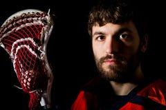 Joueur de lacrosse, pousse de studio sur le fond noir photos libres de droits