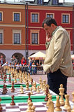 Joueur de positionnement d'échecs Photographie stock