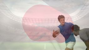Joueur de rugby abordé vers le bas par un autre drapeau japonais de joueur de rugby banque de vidéos