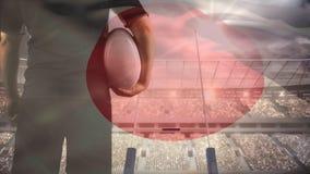 Joueur de rugby tenant le football banque de vidéos