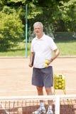 Joueur de tennis actif Photographie stock libre de droits
