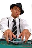Joueur de tisonnier s'occupant des cartes Image libre de droits