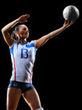 Joueur de volleyball professionnel féminin sur le noir Photographie stock